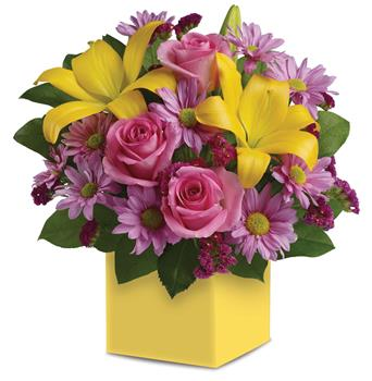 Description: A joyous surprise, this bright, beautiful box arrangement of pink roses, golden lilies and lavender daisies is sure to please.