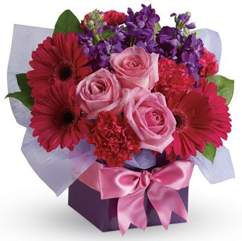 Description: A stunning study in contrasts, this fabulously feminine arrangement mixes pale pink roses with hot pink gerberas and purple stock. A simple way to show you care!