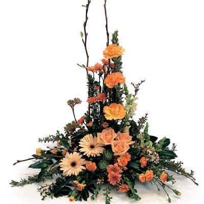 Description: This lovely arrangement is pretty favourites and greenery.