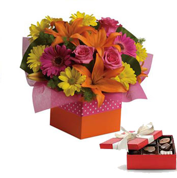 Description: Joyful moments call for happy flowers! This box of blooms does the trick with orange lilies, pink roses, yellow daisies and hot pink gerberas.