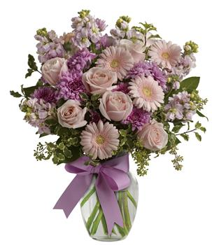 Description: Simply divine. Send them a slice of heaven with this lavish presentation of roses, gerberas and stock in a vase.