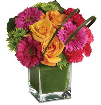Description: It is party time! And this ravishingly radiant array of orange roses and hot pink favourites presented in a leaf lined vase, is ready to get the show on the road.