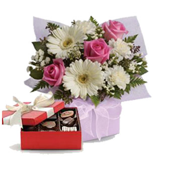 Description: Share your sweet thoughts with this lady like arrangement of pure white gerberas, candy pink roses and soft white carnations.