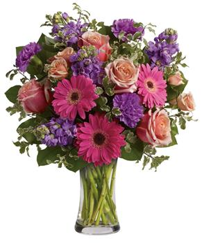 Description: Give the gift of pure bliss! Lush, lavish and luxurious, this beautiful bouquet of roses, gerberas, stock and carnations in a vase is an instant mood enhancer.