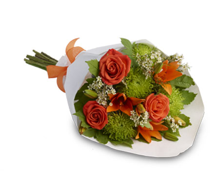 Description: A beautiful, classic bouquet presented in a decorative bag.