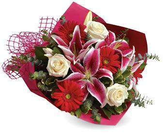 Description: Show someone how much you love them with this gorgeous bouquet of lilies, roses and gerberas.