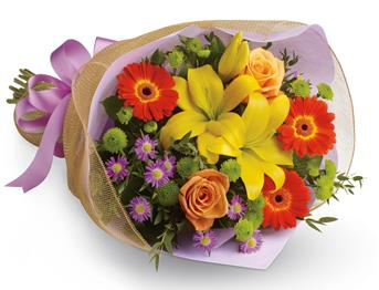 Description: A burst of brilliant flowers designed to make their spirits soar! This spectacularly colourful bouquet includes lilies, gerberas and roses.