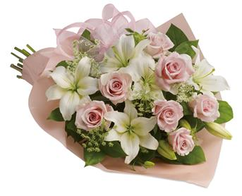 Description: Stunning in its simplicity, this innocent harmony of roses and lilies are a heartfelt way to send your very best.