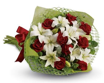 Description: Add some romance with this rich bouquet of luxurious red roses and white lilies.