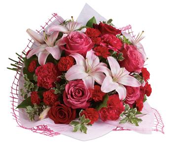 Description: Give a bouquet that will completely capture her heart.A classic gift of roses and lilies that will truly delight!