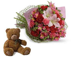 Description: Tell someone you love them with this romantic bouquet which includes roses, lilies, alstroemeria and carnations.