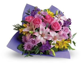 Description: Contemporary yet classic, this bouquet includes an elegant mix of roses, lilies and alstroemeria.