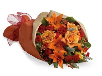 Description: Beautiful and breathtaking as a sunset. This bouquet contains lilies, roses and mini carnations in ravishing shades of oranges and reds.