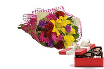 Description: Let the sun shine in with this exuberant bouquet of golden lilies, rich red roses and hot pink gerberas.