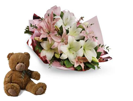Description: Stunning in its simplicity, this innocent harmony of light pink roses and snow white lilies are a heartfelt way to send your very best.