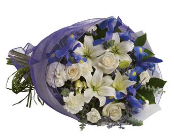 Description: Capture the magic of twilight with this enchanting array of luxurious lilies, roses and iris.