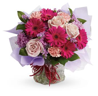 Description: Treat them to a special surprise! Hot pink gerbera mix with pale pink roses and carnations in this delightfully delicious bouquet.