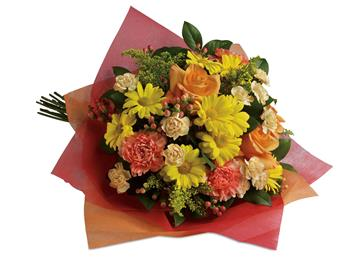 Description: Tickle their fancy with this playful mix of yellow daisies,pink carnations and peach roses.