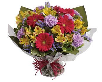 Description: Unexpected gifts are the best gifts! Send one they will never forget with this sweet bouquet of hot pink, yellow and purple blooms.