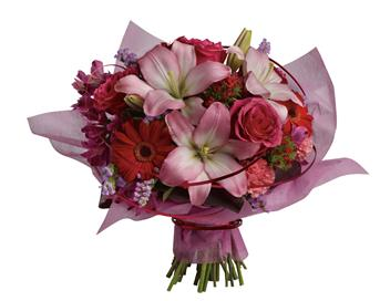 Description: This stylish array of roses, lilies and gerberas makes yours a sophisticated statement of affection.