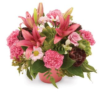 Description: Modern arrangement of lilies, chrysanthemums and carnations add a touch of something different.