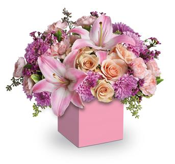 Description: Perfectly peach spray roses, asiatic lilies, carnations and spray chrysanthemums fill this cute mini box.