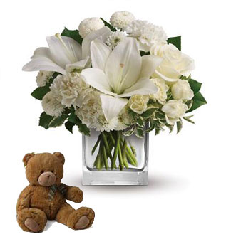 Description: Wish upon a star, but seal the deal with the pure white perfection of this luxurious cube arrangement. These fresh and fragrant flowers will make you the star of her heart!