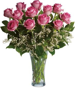 Description: This lush arrangement of hot pink roses and greenery can be a fabulously romantic gift.