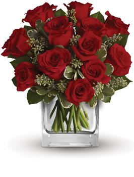 Description: Turn up the heat on a new romance or a lifelong love affair with this classic cube arrangement of one dozen red roses.