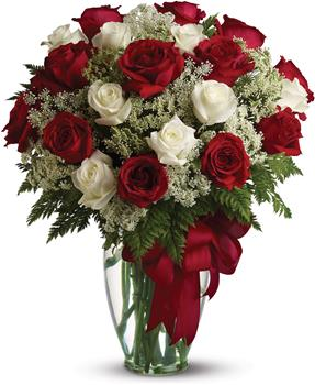 Description: Loves divine, and roses are too. This beautiful vase arrangement of red and white roses is a timeless gift for your beloved.