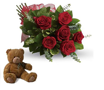 Description: They will fall in love with you all over again when you surprise them with this perfectly petite bouquet of six sensational roses amidst beautiful fresh greens.