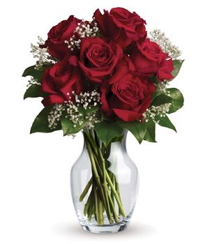 Description: What a delight! Six stunning roses put your love centre stage in this charming vase arrangement.