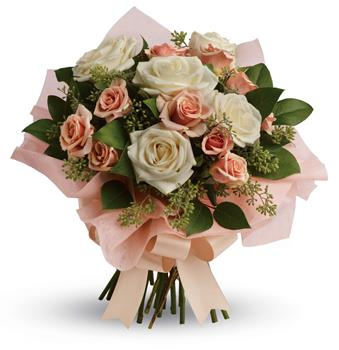 Description: A fresh, feminine spin on the classic rose bouquet, this creamy mix of peach and cream roses is the ultimate in romance.
