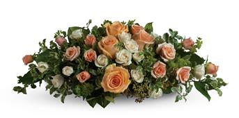 Description: Set the scene for romance with this lavish table arrangement of peach, pink and cream roses. Beautiful on an entry table, too!