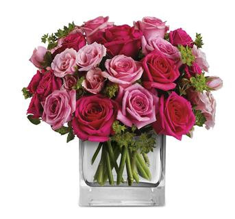 Description: This exquisite arrangement of light pink and hot pink roses, is a gift that will long be remembered.