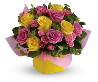 Description: This stunning arrangement of pink and yellow roses adds an instant smile to anyones face.