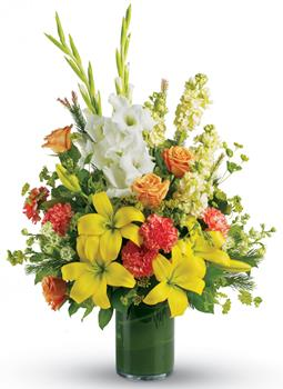 Description: Create a bright, heart-warming tribute to the special person who lit up everyones lives. Send a stunning leaf lined vase arrangement of golden lilies, white gladiolus and peach roses.