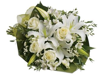 Description: An elegant expression of sympathy, this wondrous white bouquet conveys purity and peace.