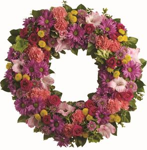 Description: The memory of brighter days is always a comfort to those in mourning. This lovely wreath will display your compassion beautifully.