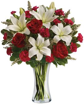Description: Timeless romantic red roses and fragrant white lilies in a classic glass vase - a sweet yet spectacular way to express what is in your heart.