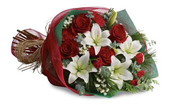 Description: Take your gift-giving to new heights with this dramatic arrangement! Classic red roses, snowy lilies and naturally festive berries are presented in a complementing vase.