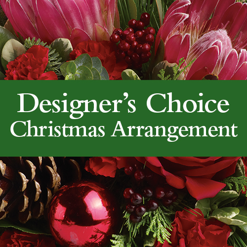 Description: Our florist will design a stunning Christmas arrangement for you, our most popular choice.