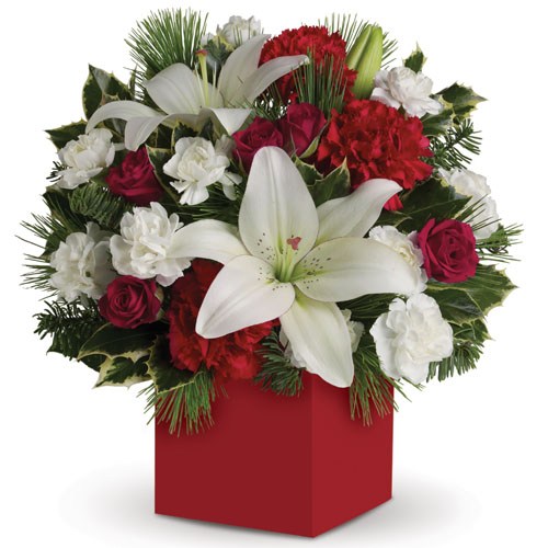 Description: Have yourself a modern little Christmas with a box arrangement of delightful red roses, white lilies and carnations accented with greenery.