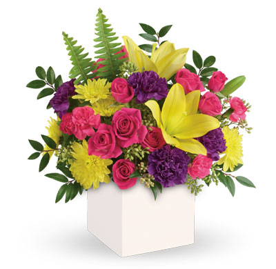Description: Colour their day happy with this bright surprise! Artfully arranged, this sunny bouquet of yellow lilies and hot pink roses celebrates them in style.