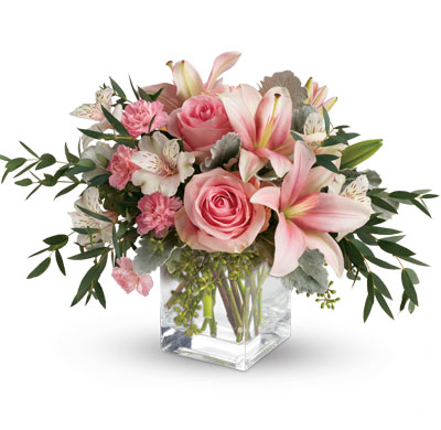 Description: Just fabulous! From its perky vase and perfect pink roses, to its textural greens and dramatic pink lilies, this chic bouquet is flora at its finest!