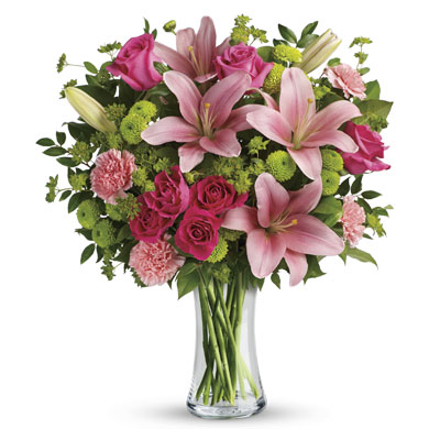 Description: What's better than pink? More pink! Lavish your loved one with this blissful bouquet of roses and lilies, hand-delivered in a classic glass vase. It's an impressive gift that promises to put some pink in her cheeks!